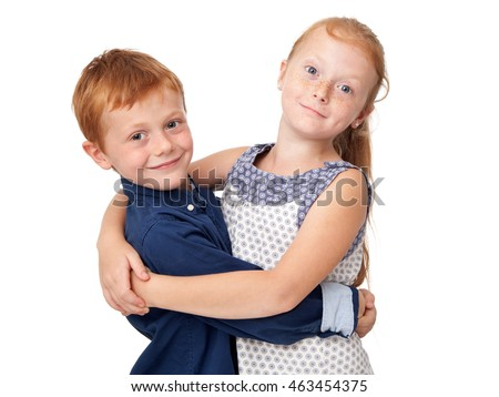 Cute redhead brother and sister are hugging, isolated on white background