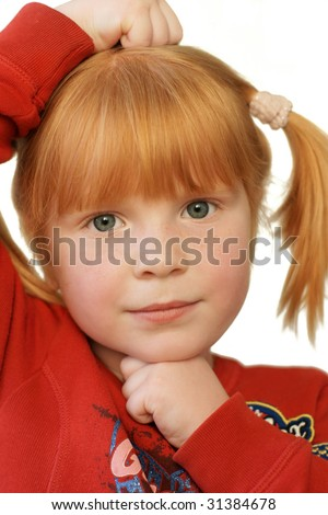 cute redhead girl with very serious expression - stock photo