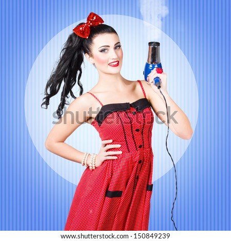 Cute 50s cartoon pinup girl shooting with hairdryer when getting a smoking hot blow dry and style. Beauty salon hair styling concept - stock photo