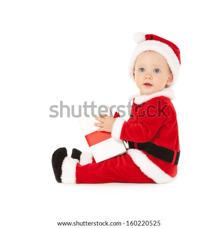 Cute santa baby with beautiful blue eyes on the white background