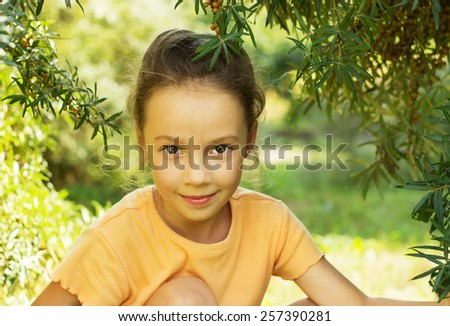 Cute school girl is smiling in sunny day - stock photo