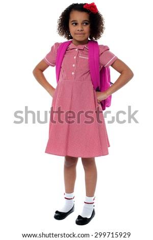 Cute school girl posing with hands on waist - stock photo