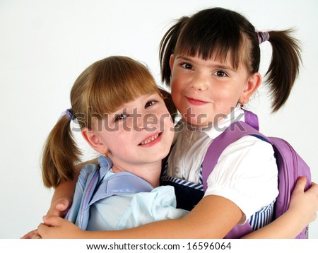cute school girls hugging each other