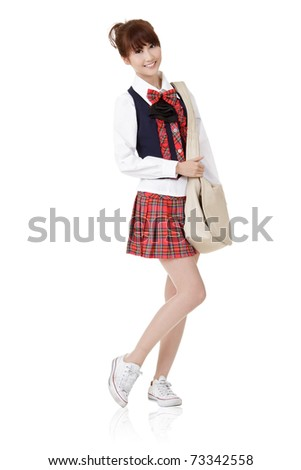 Cute school student girl of Asian carry schoolbag, full length portrait isolated on white background.