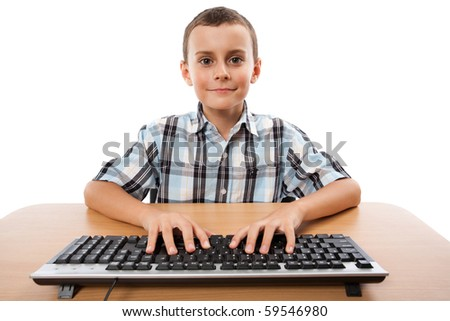 Cute schoolboy using keyboard from his PC, isolated on white - stock photo