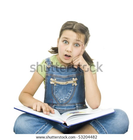 Cute schoolgirl reading a book - stock photo