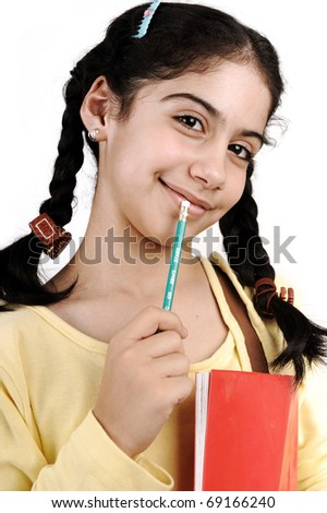 Cute schoolgirl thinking, notebook held in arm and pencil in mouth :)  Isolated - stock photo