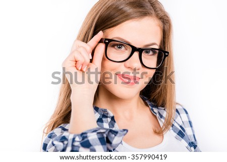 cute schoolgirl with glasses stands on a white background - stock photo