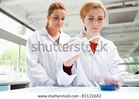 Cute scientists doing an experiment in a laboratory