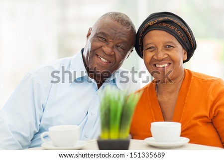 cute senior african couple portrait at home - stock photo