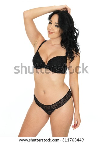 Cute Sensual Sexy Attractive Young Hispanic Pin Up Model Wearing Black Lingerie Against A White Background