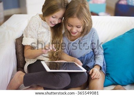 Cute siblings affectionated with a game - stock photo