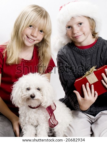 Cute Siblings and their Puppy Dog in the Christmas Spirit! - stock photo