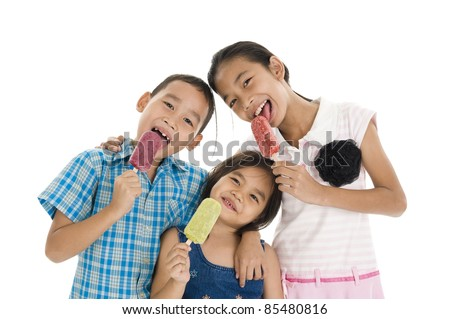 cute siblings enjoying their ice creams over white background - stock photo