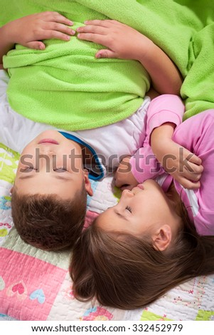 Cute Siblings sleeping in the bedroom