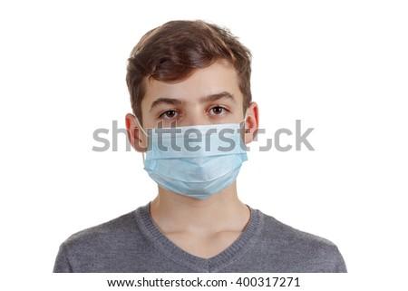 Cute sick boy in a mask - stock photo