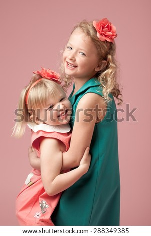 Cute Sisters playing in Studio - stock photo