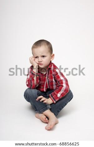 Cute sitting boy - stock photo