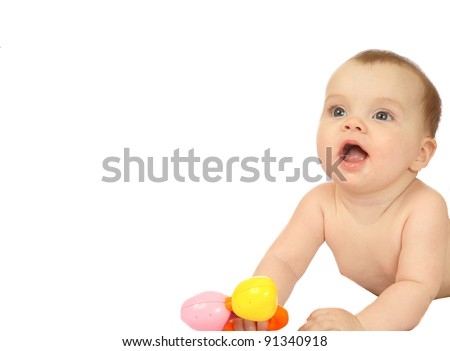 cute six months old baby girl playing with a toy, isolated on white background