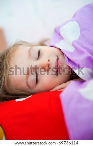 Cute sleep girl on the bed