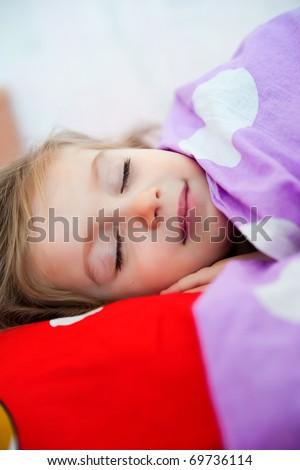 Cute sleep girl on the bed - stock photo