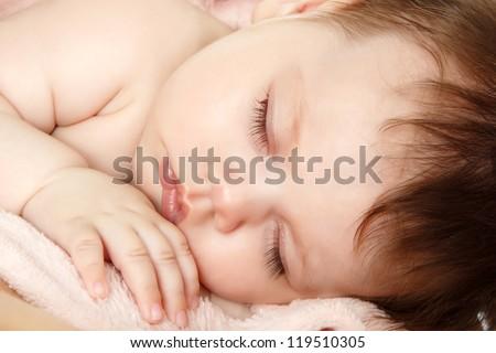 cute sleeping baby, beautiful kid's face closeup, studio shot - stock photo