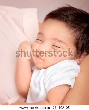 Cute sleeping baby portrait, mother holding on hands sweet newborn toddler, happy childhood, new life concept