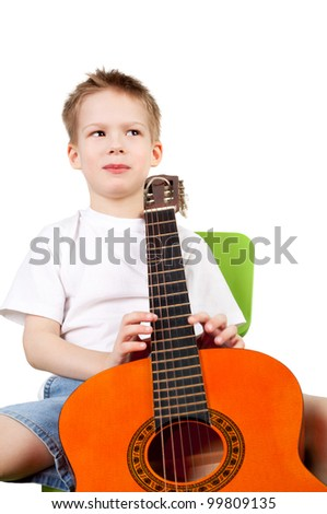 cute sly handsome little boy with the guitar