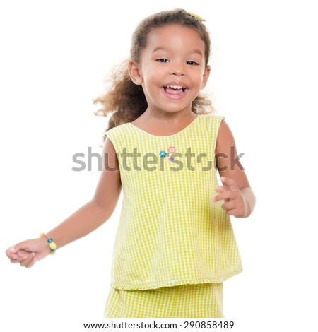 Cute small african-american or hispanic girl laughing and having fun isolated on white - stock photo