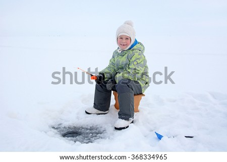 Cute small blonde girl fishing - stock photo