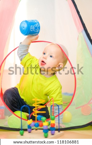 Cute small boy playing at home - stock photo