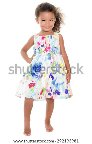 Cute small girl wearing a flowers summer dress isolated on white - stock photo
