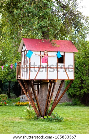 Cute Small Tree House For Kids On Backyard. Girl Inside.