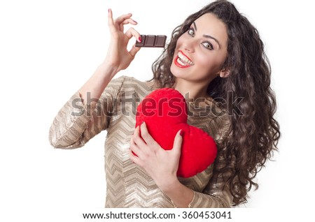 Cute, smiley curly hair brunette love eating chocolate concept, isolated on white - stock photo