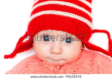 Cute smiling baby in red hat on white - stock photo