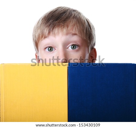 Cute smiling boy in yellow t-shirt with his eyes closed dreaming (isolated on white background) - stock photo