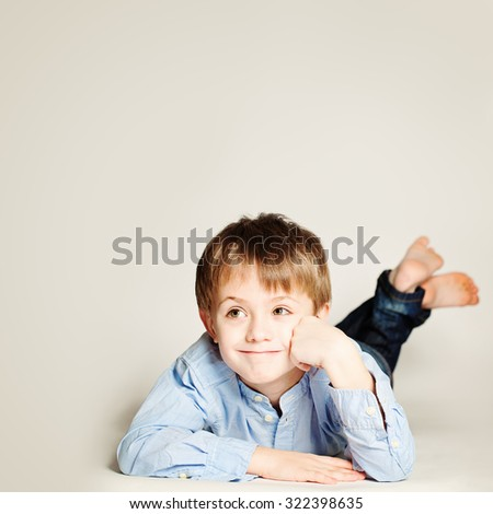 Cute Smiling Child. Little Boy Dreaming and Looking Up, Portrait - stock photo