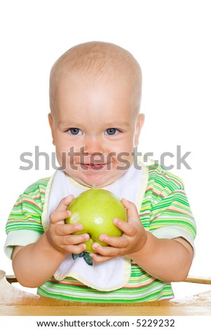 Cute smiling child with green apple. Isolated over white - stock photo