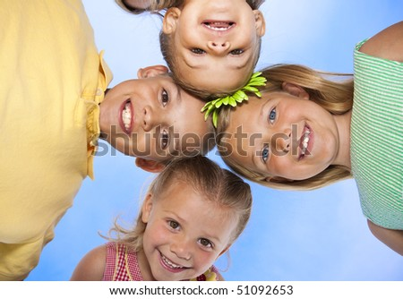 Cute, smiling faces of adorable children having fun together - stock photo