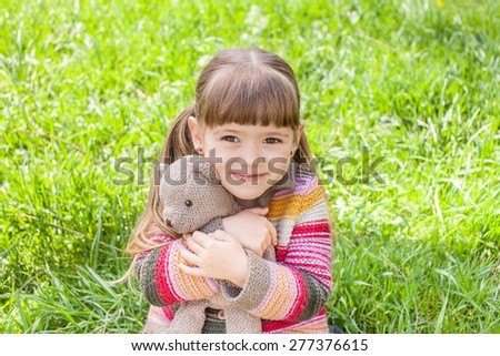 Cute smiling four year old girl with toy
