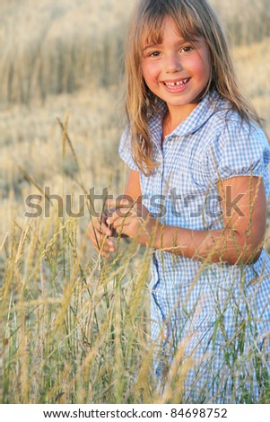cute smiling girl in grass - stock photo