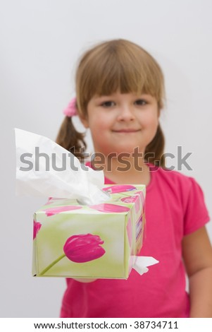cute, smiling girl inviting to take a handkerchief - stock photo