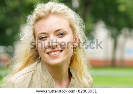 cute smiling girl posing at the nature - stock photo