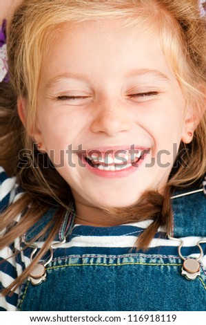 cute smiling girl with closed eyes - stock photo