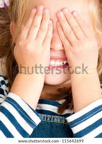 cute smiling girl with closed eyes by hands - stock photo