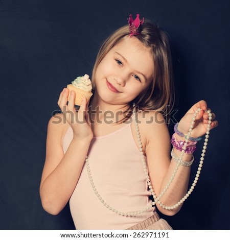 Cute smiling girl with cupcake - stock photo