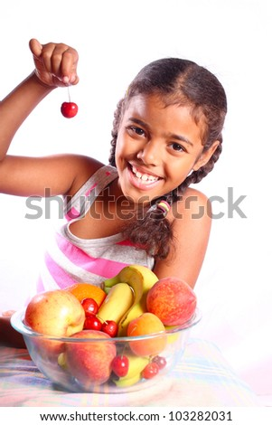 cute smiling girl with various fruits - stock photo