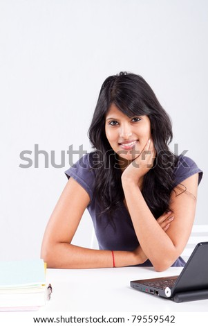 cute smiling indian female college student - stock photo