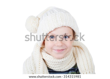 cute smiling little boy wearing knitted cap and scarf - stock photo
