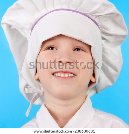 cute smiling little child dressed as a cook - stock photo